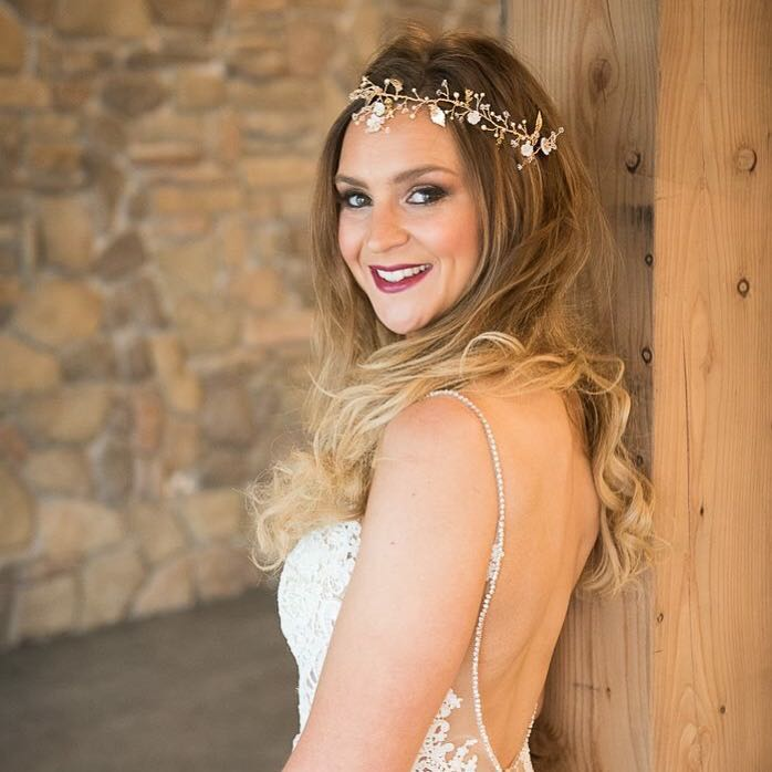 Bride with blonde hair wearing the Adele Vine with golden leaves and mother of pearl flowers.