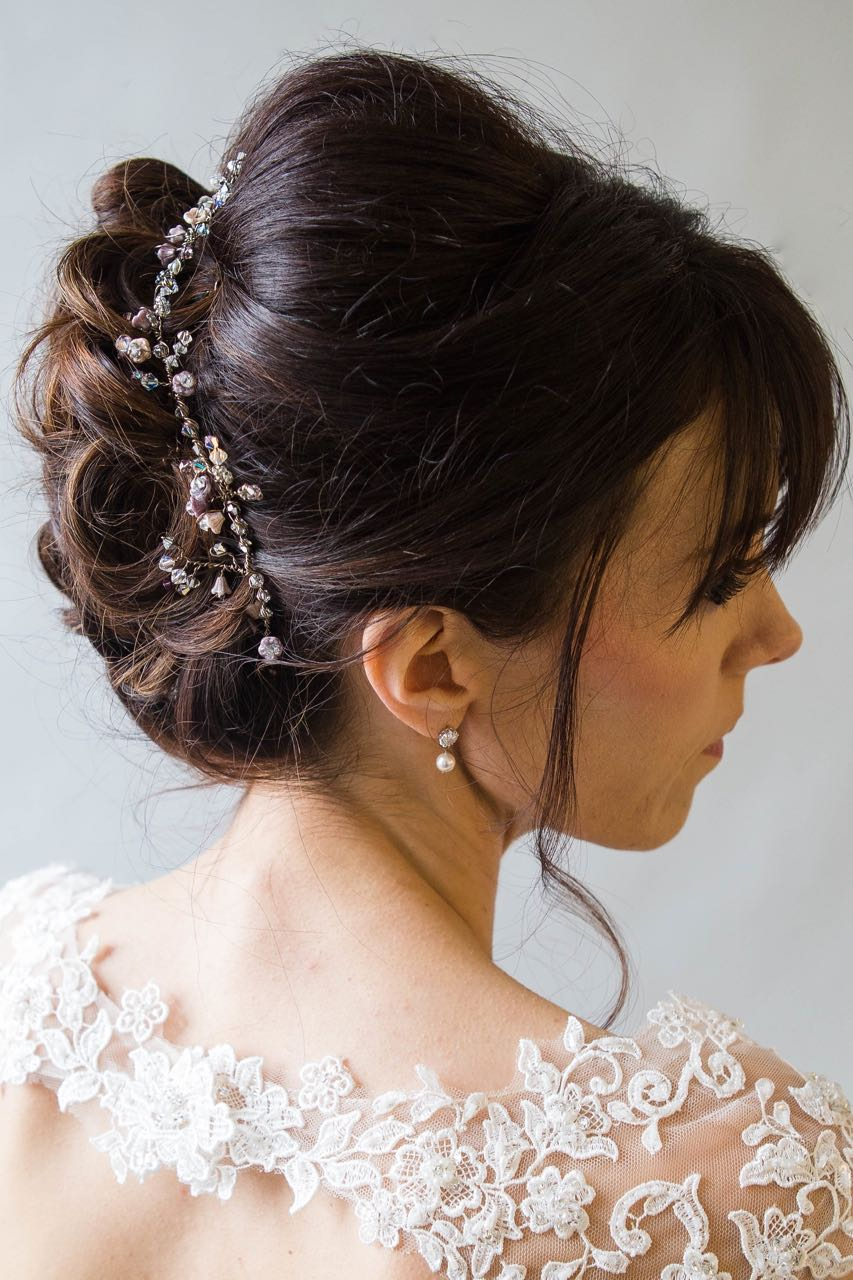 Honesty Vine at the back of an updo wedding hairstyle in brunette hair
